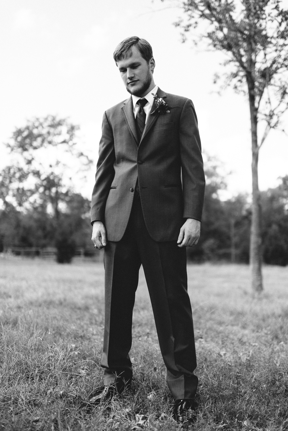 Groom Portrait Texas A&M Ring Texas Aggie Ring Boutonniere beard black and white