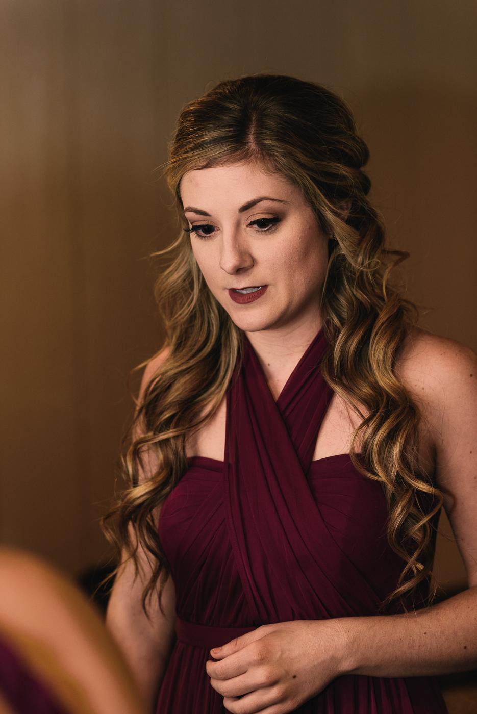 bridesmaid maroon dress hair and makeup curly hair halter top