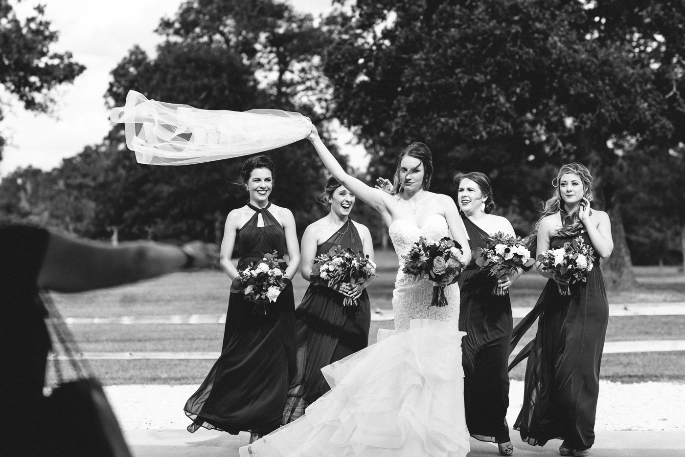 veil wind good catch black and white action shot candid shot bride and bridesmaids