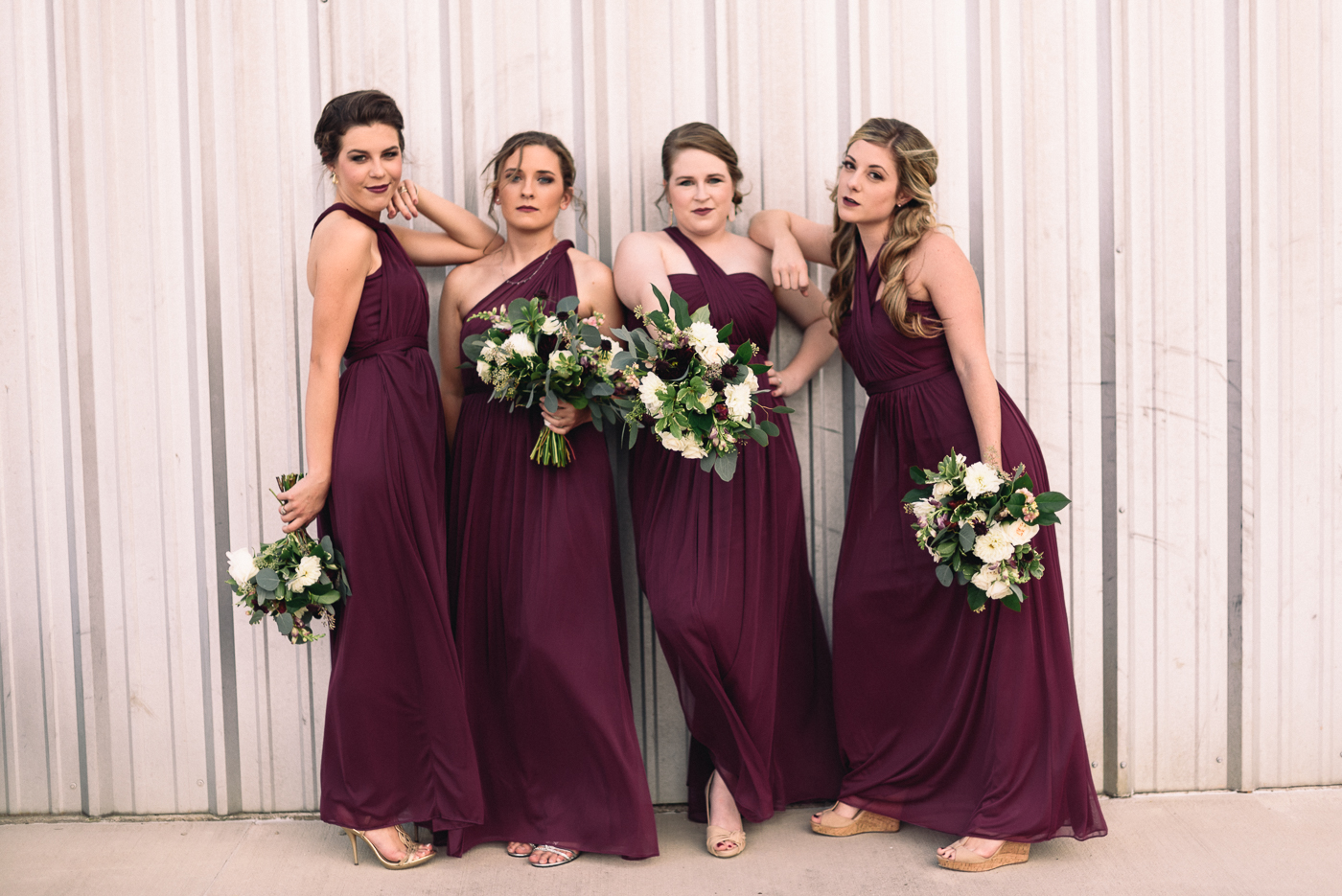 sassy bridesmaids maroon dresses bouquet
