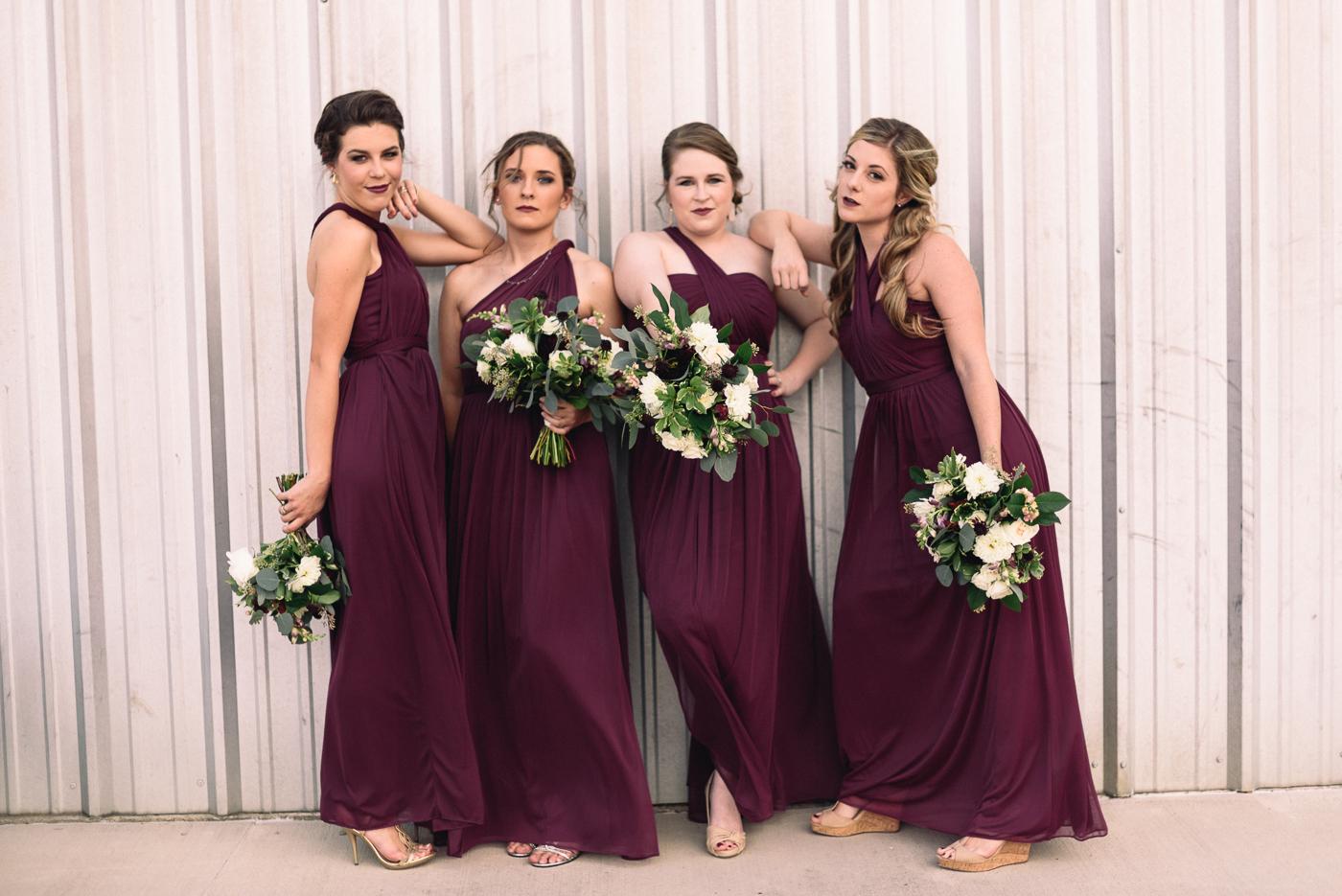 sassy bridesmaids maroon dresses bouquet
