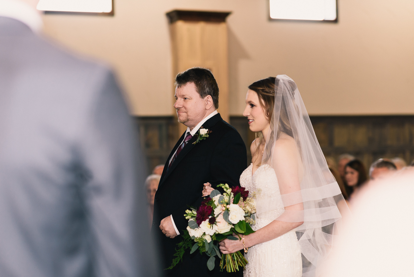 Father of the bride walking down the aisle wedding bouquet