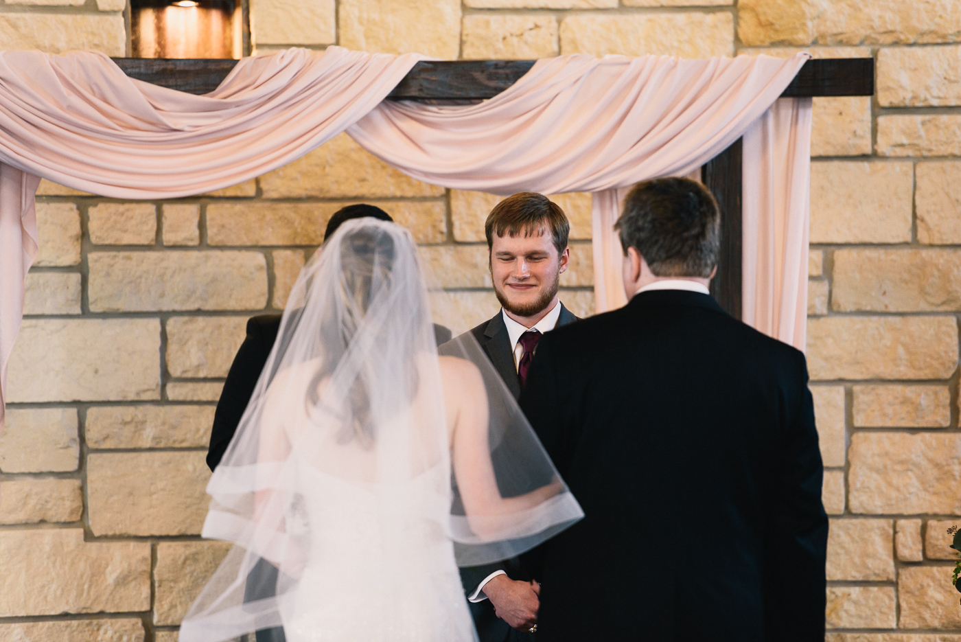 Giving away the bride wedding ceremony bride and groom father of the bride wedding arch