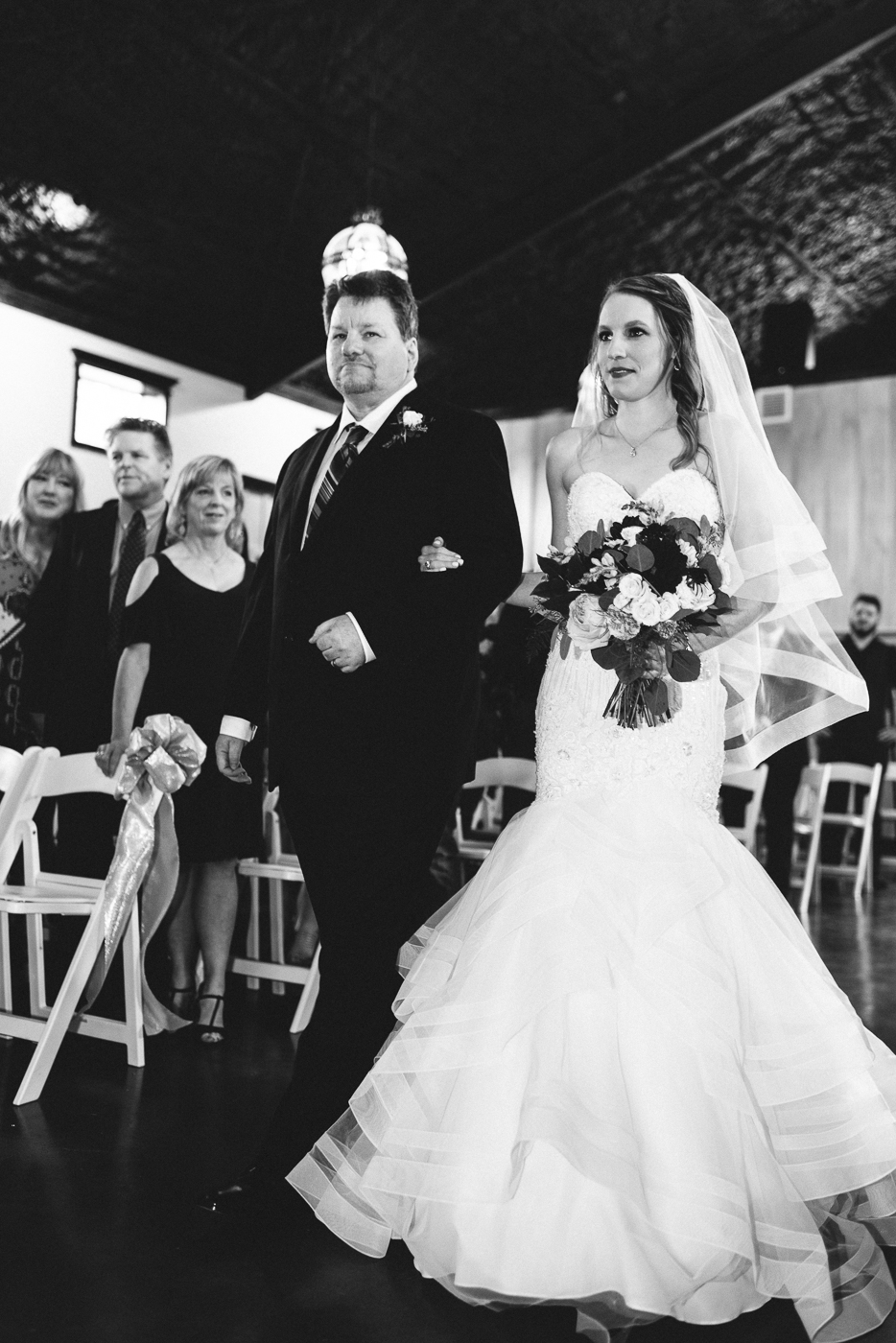 Father of the bride black and white walking down the aisle