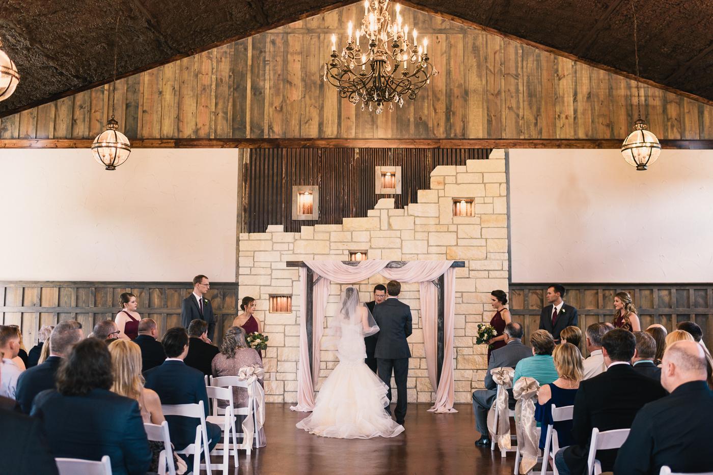 wedding ceremony bride and groom wedding arch
