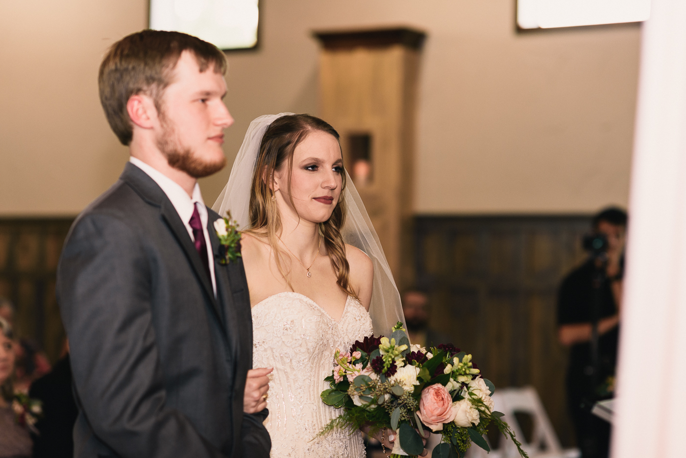 wedding ceremony bride and groom veil bouquet at the altar