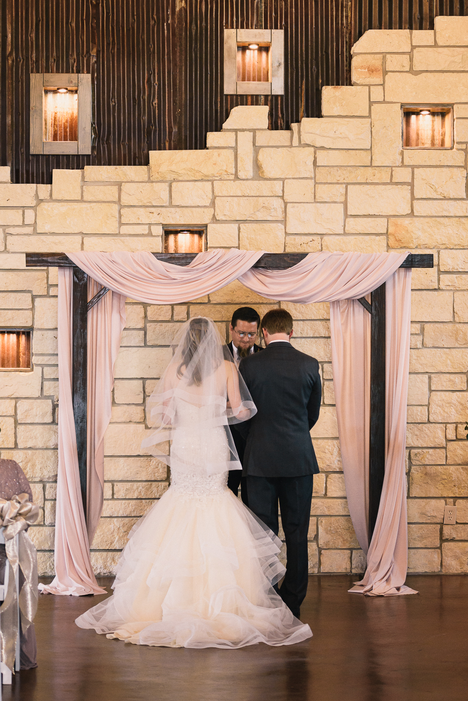 Bride and Groom wedding ceremony altar officiant pink mermaid gown