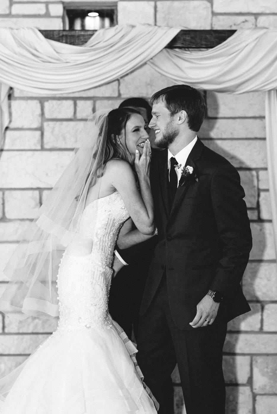 wedding ceremony black and white first kiss bride and groom wedding ceremony