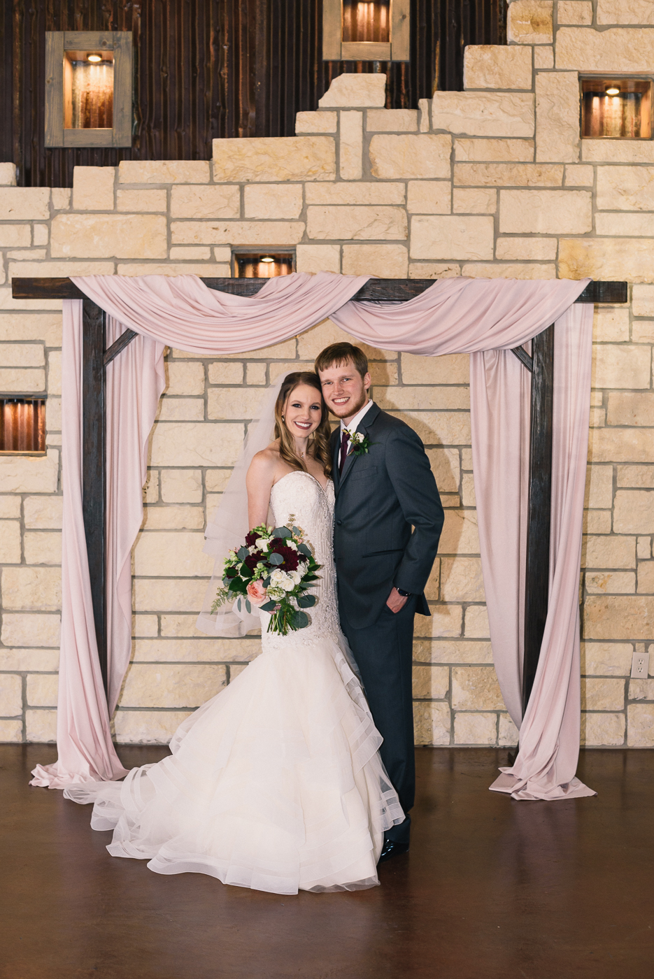 Wedding altar bride and groom husband and wife mermaid gown wedding bouquet wedding portrait