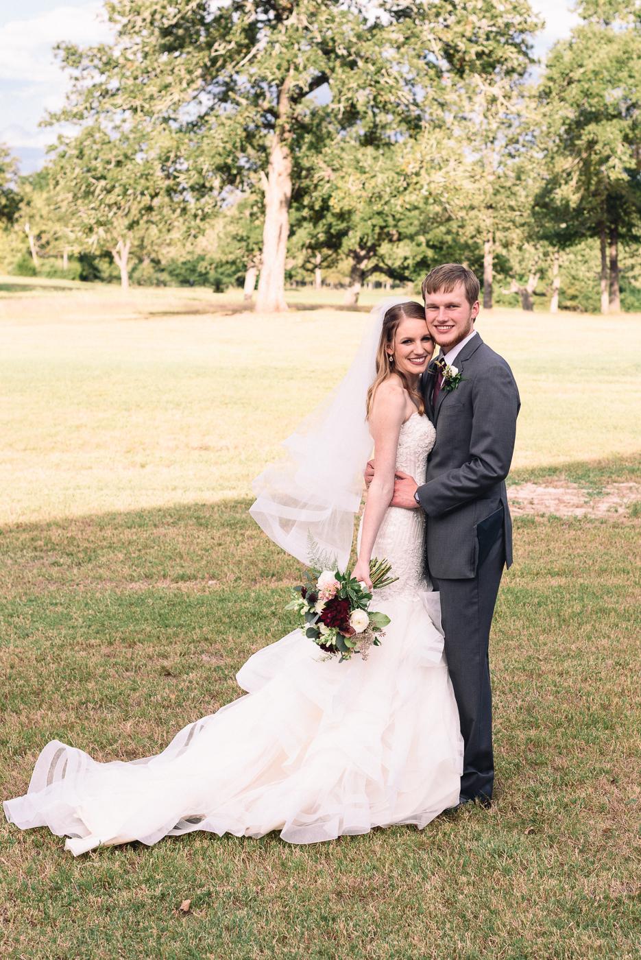 Husband and wife wedding portrait broken arrow ranch college station wedding gown train
