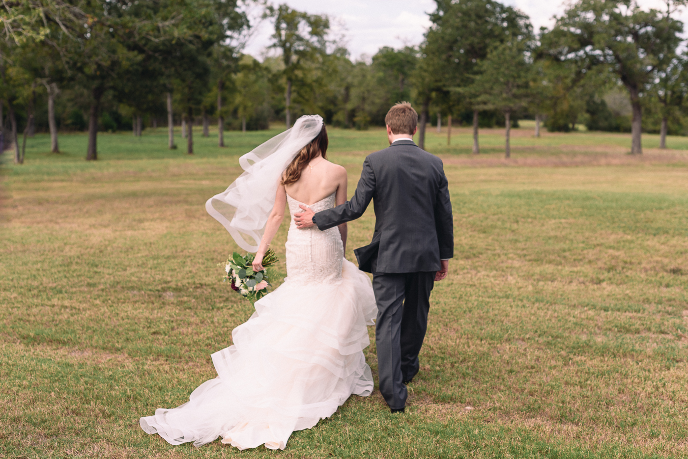 husband and wife wedding portrait candid shot veil wedding bouquet