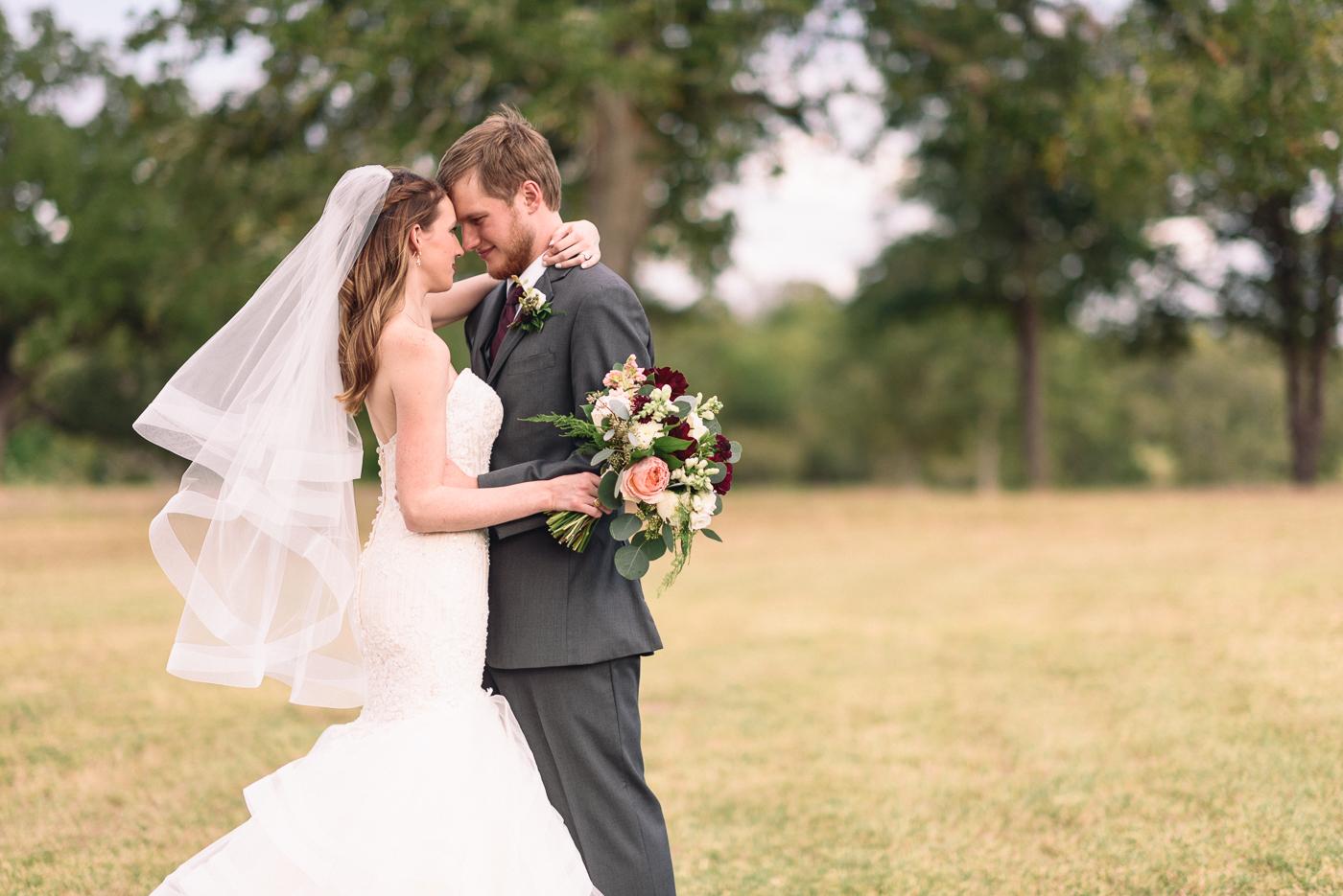 husband and wife wedding portrait wedding bouquet