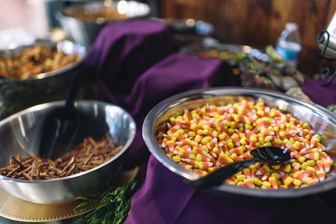 wedding reception snack table candy corn pretzels purple linen
