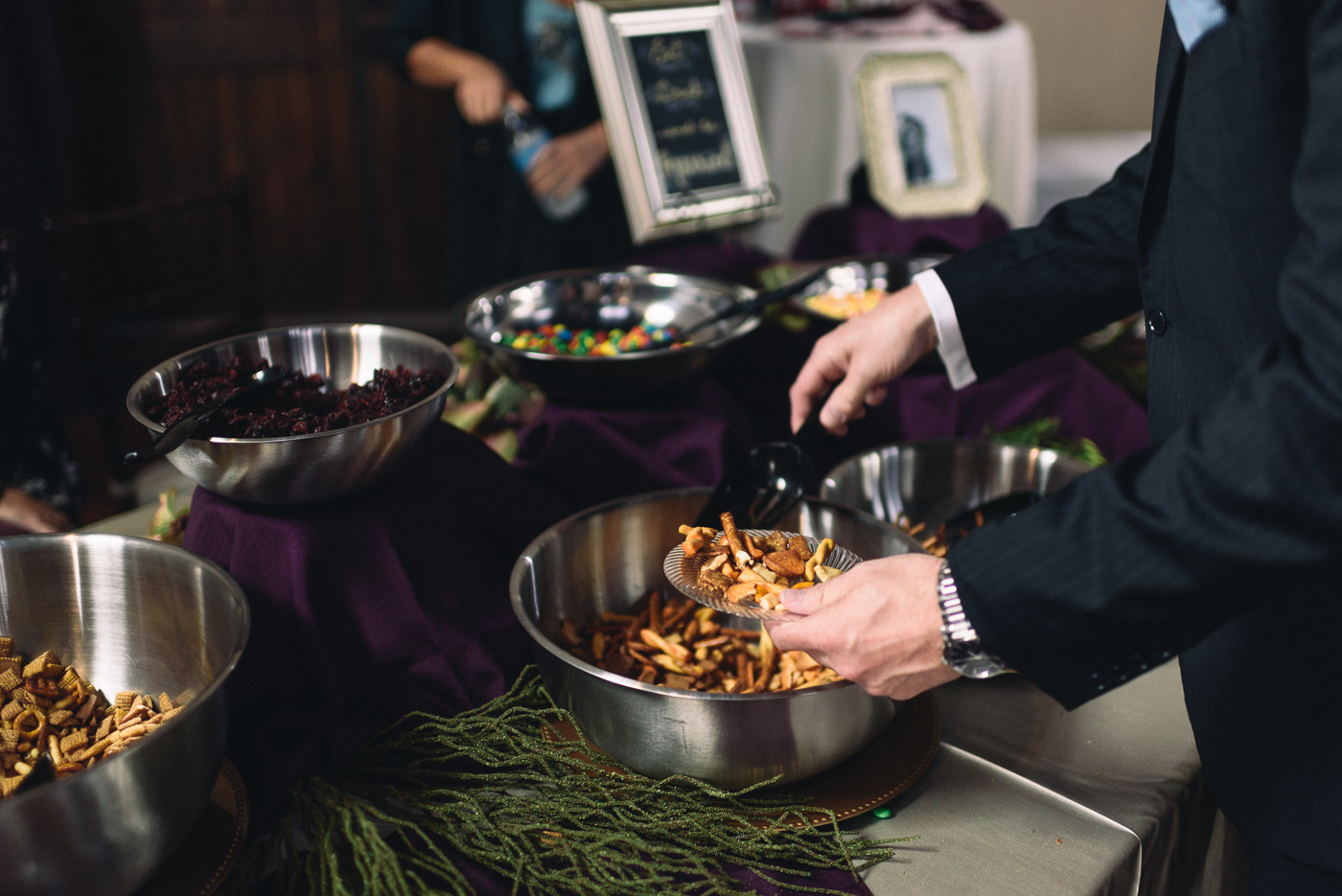 wedding reception snack table pretzels M&Ms craisins