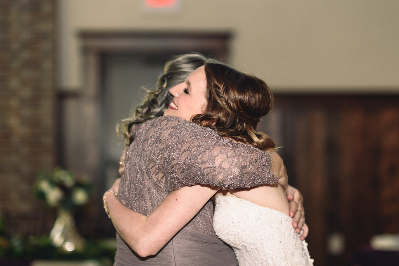 mother of the bride hug embrace beautiful