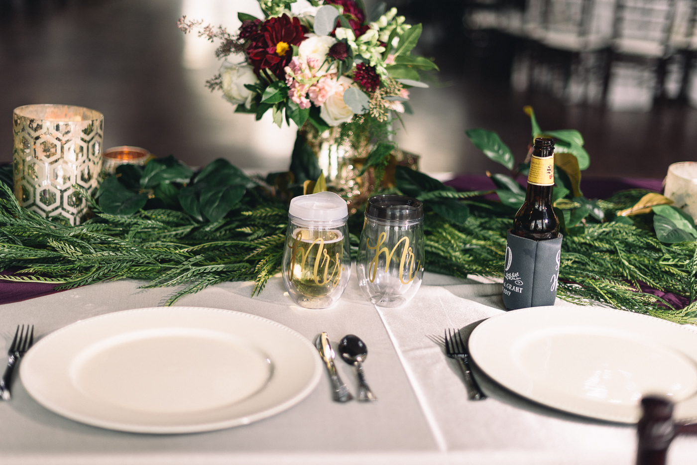wedding reception place setting shiner bock beer wedding flowers mr. and mrs. wine sippy cup