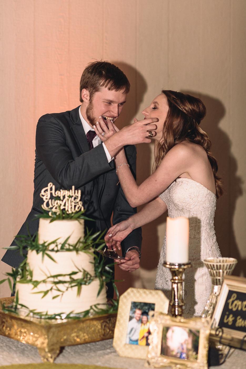 wedding reception cutting the cake chocolate