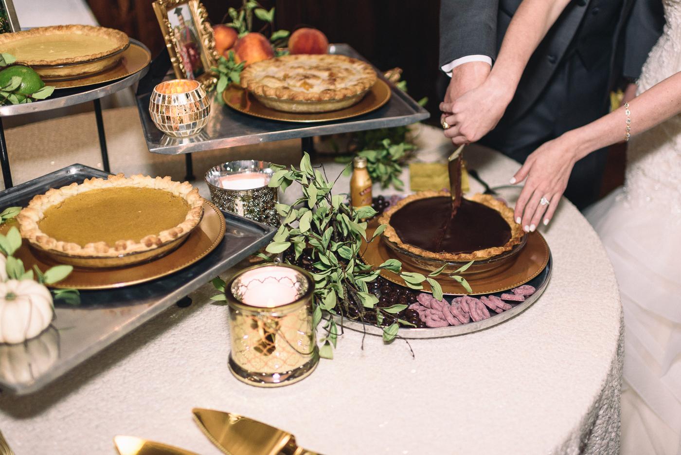 wedding reception dessert table chocolate pie pumpkin pie key lime peach cobbler