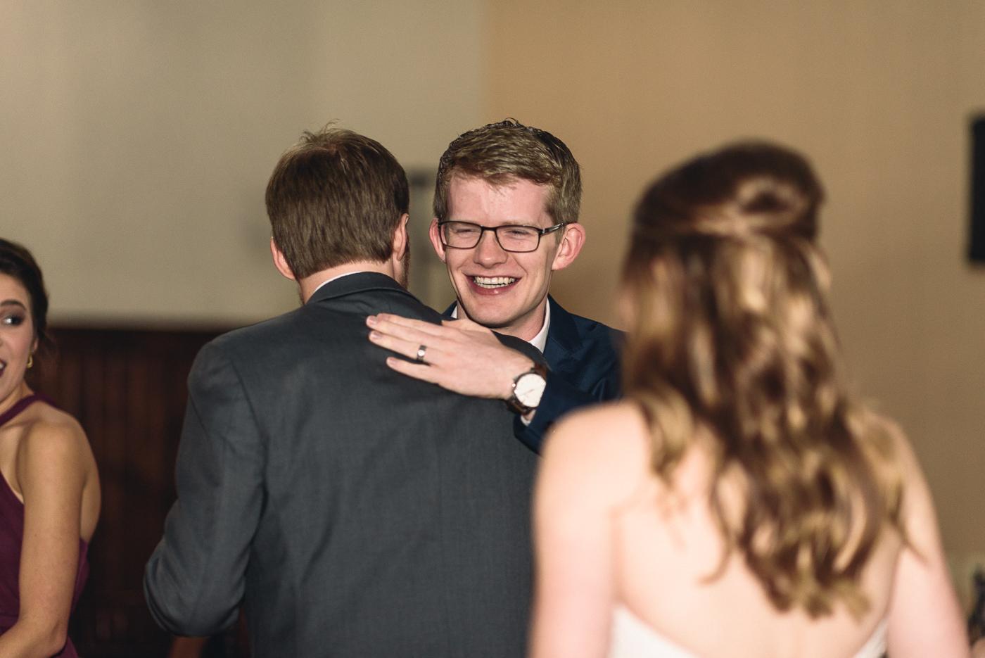 wedding reception hug groom cousins