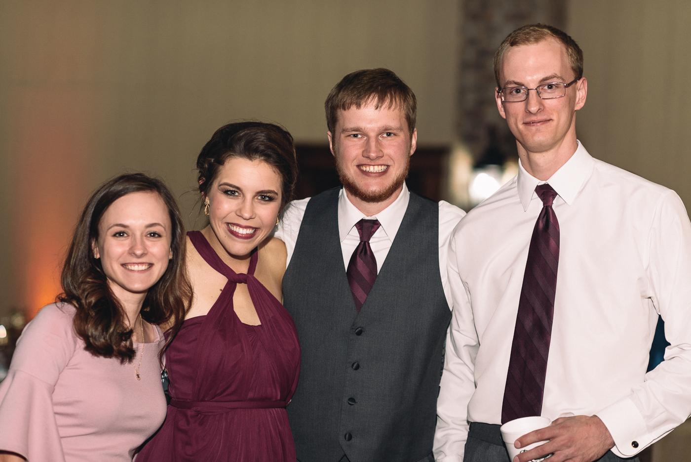 wedding reception family cousins maroon pink white