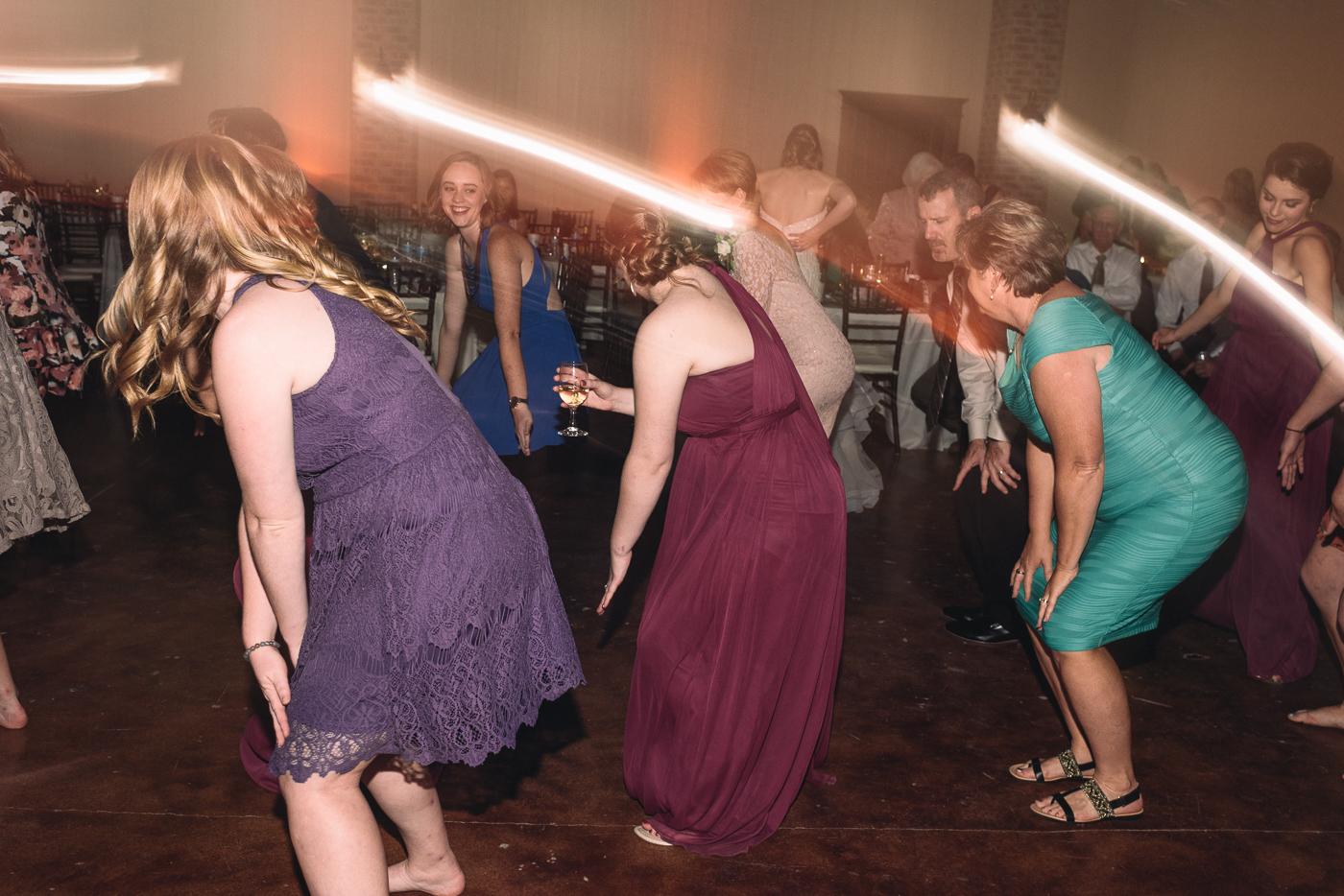 wedding ceremony dancing action shot lights blur