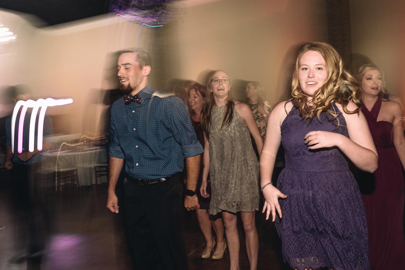 wedding reception action shot bow tie blur