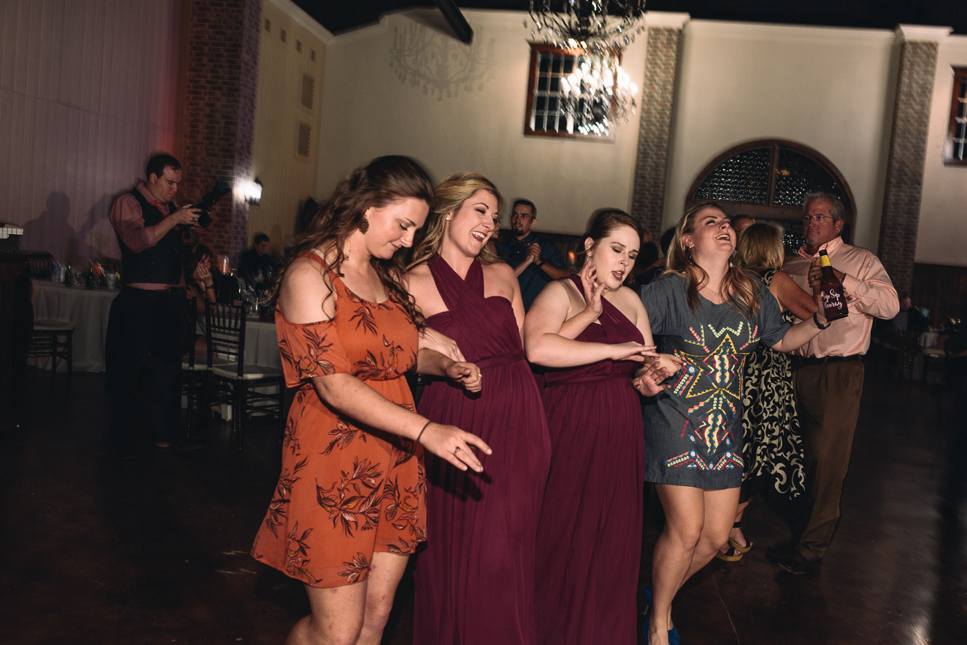 wedding reception brides maids dancing cousins maroon dress