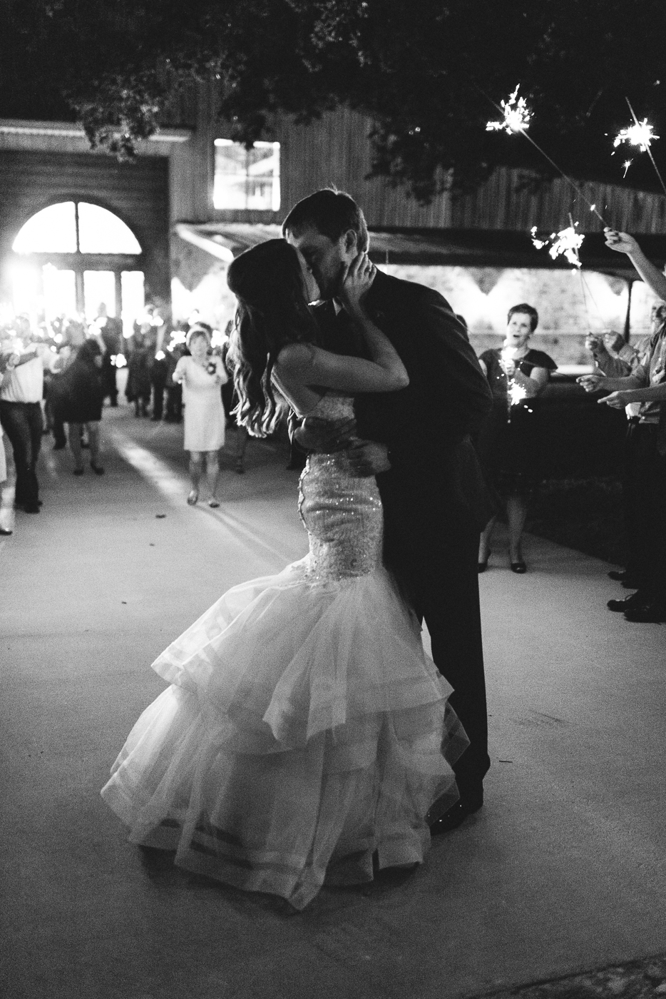 husband and wife black and white grand exit sparklers mermaid gown