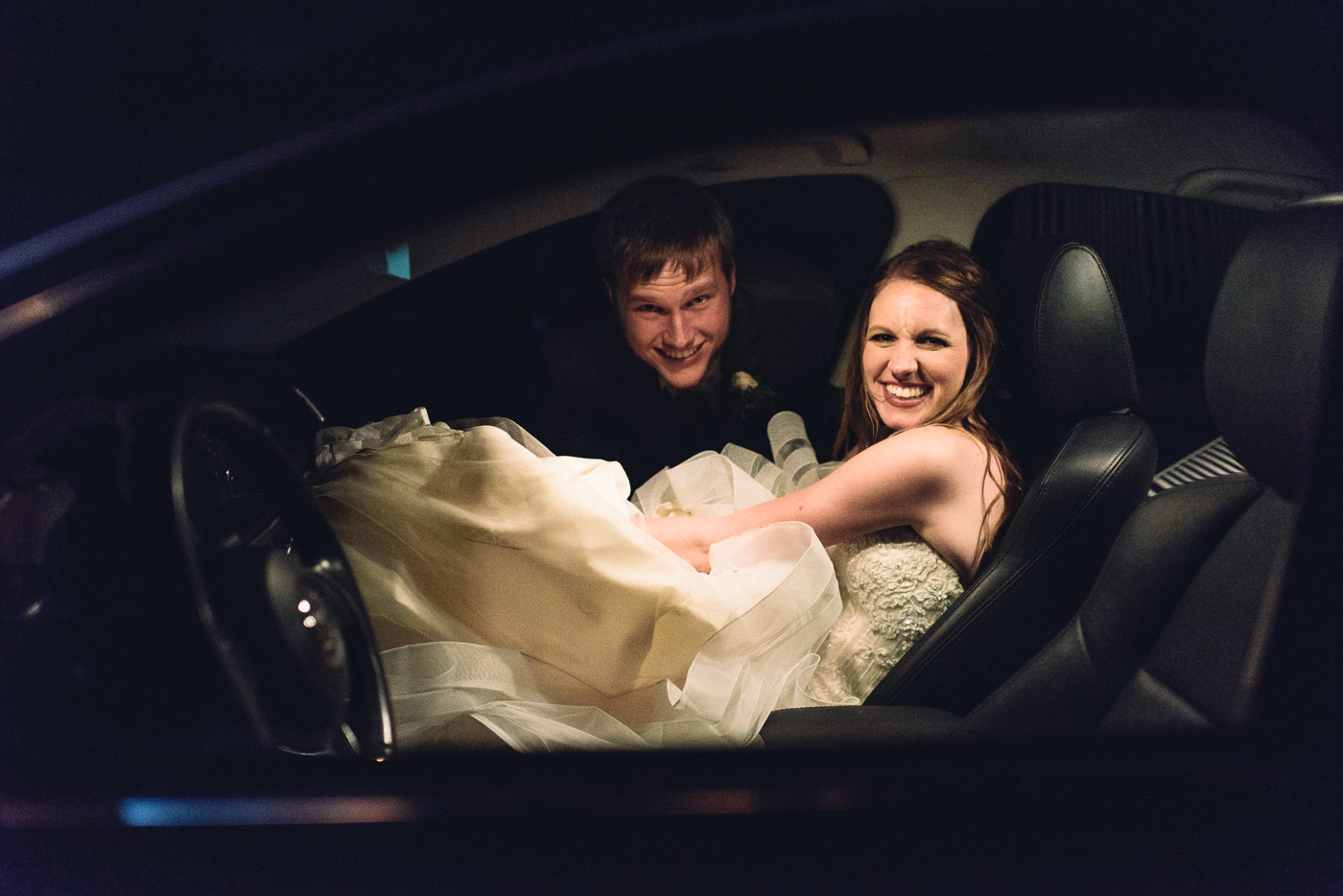 happily ever after husband and wife driving new car
