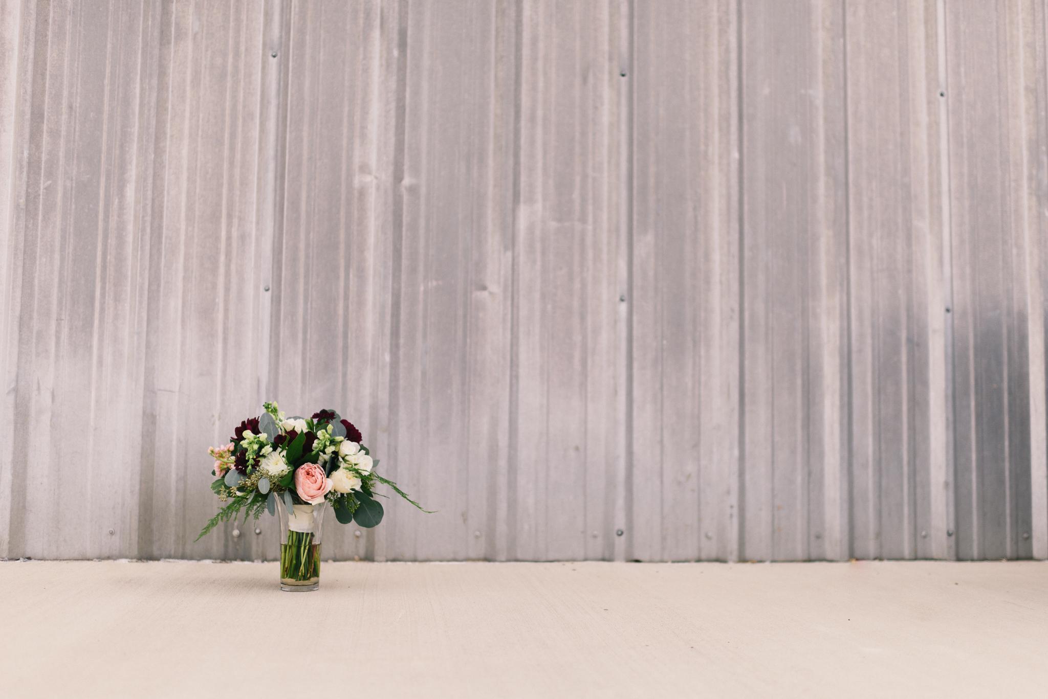 Wedding flowers sheet metal pop of color aluminum siding concrete bouquet