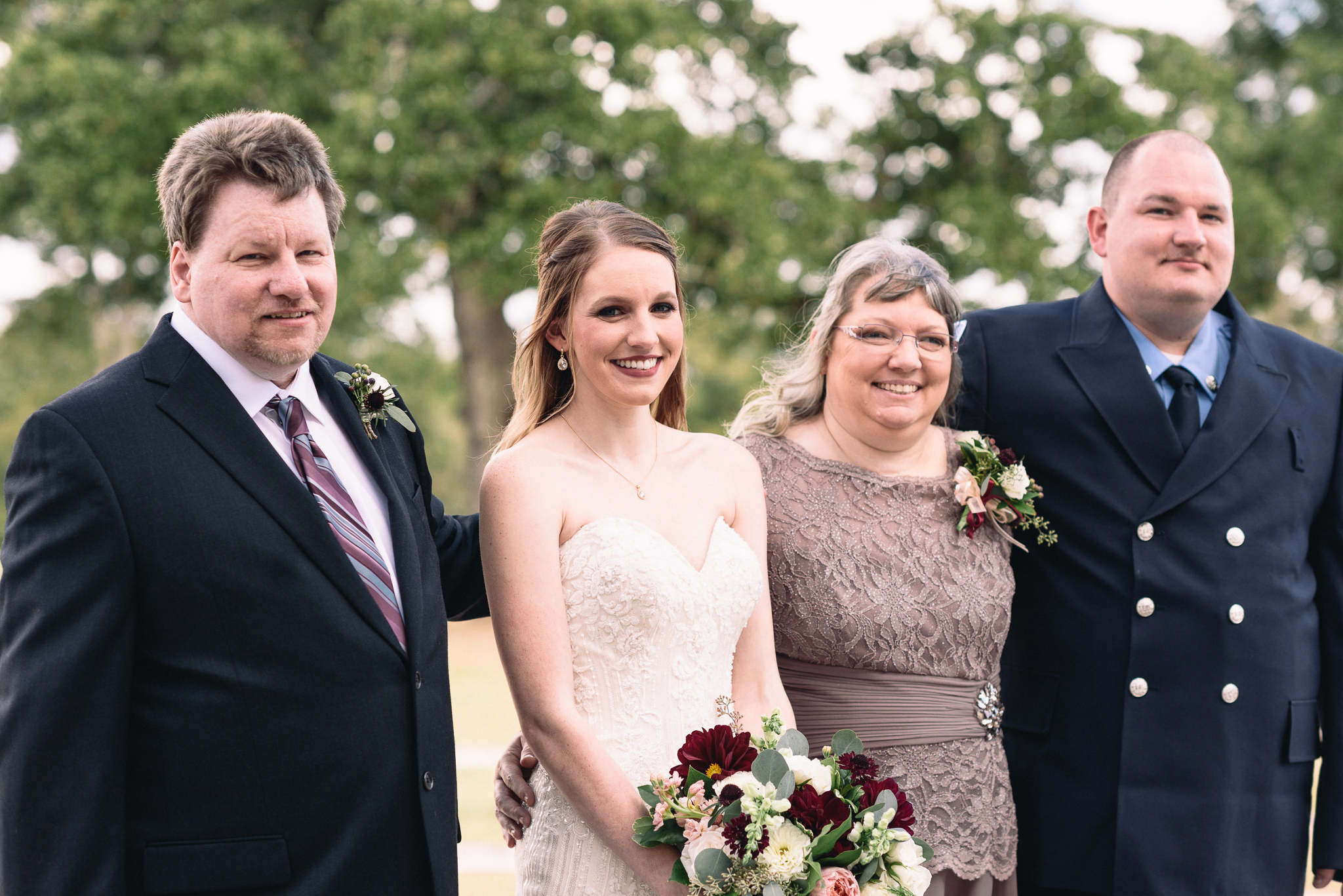 bride's family mother father brother family portrait wedding bouquet