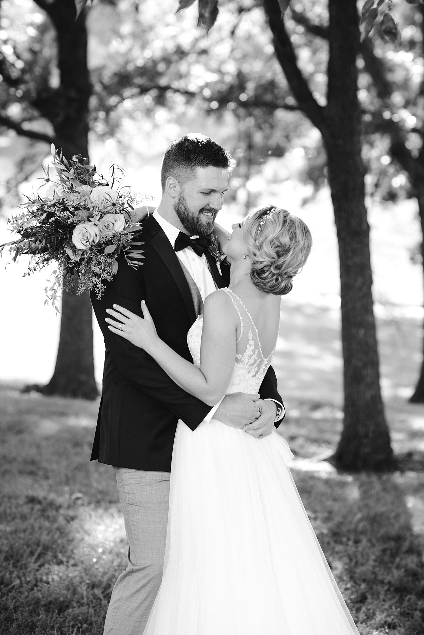 Bride groom bouquet wedding photography portrait gown suit bow tie