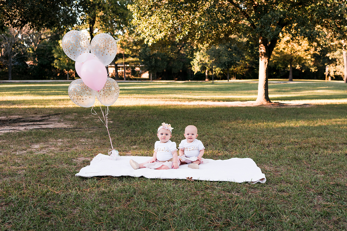 lifestyle photography twins first birthday balloons park