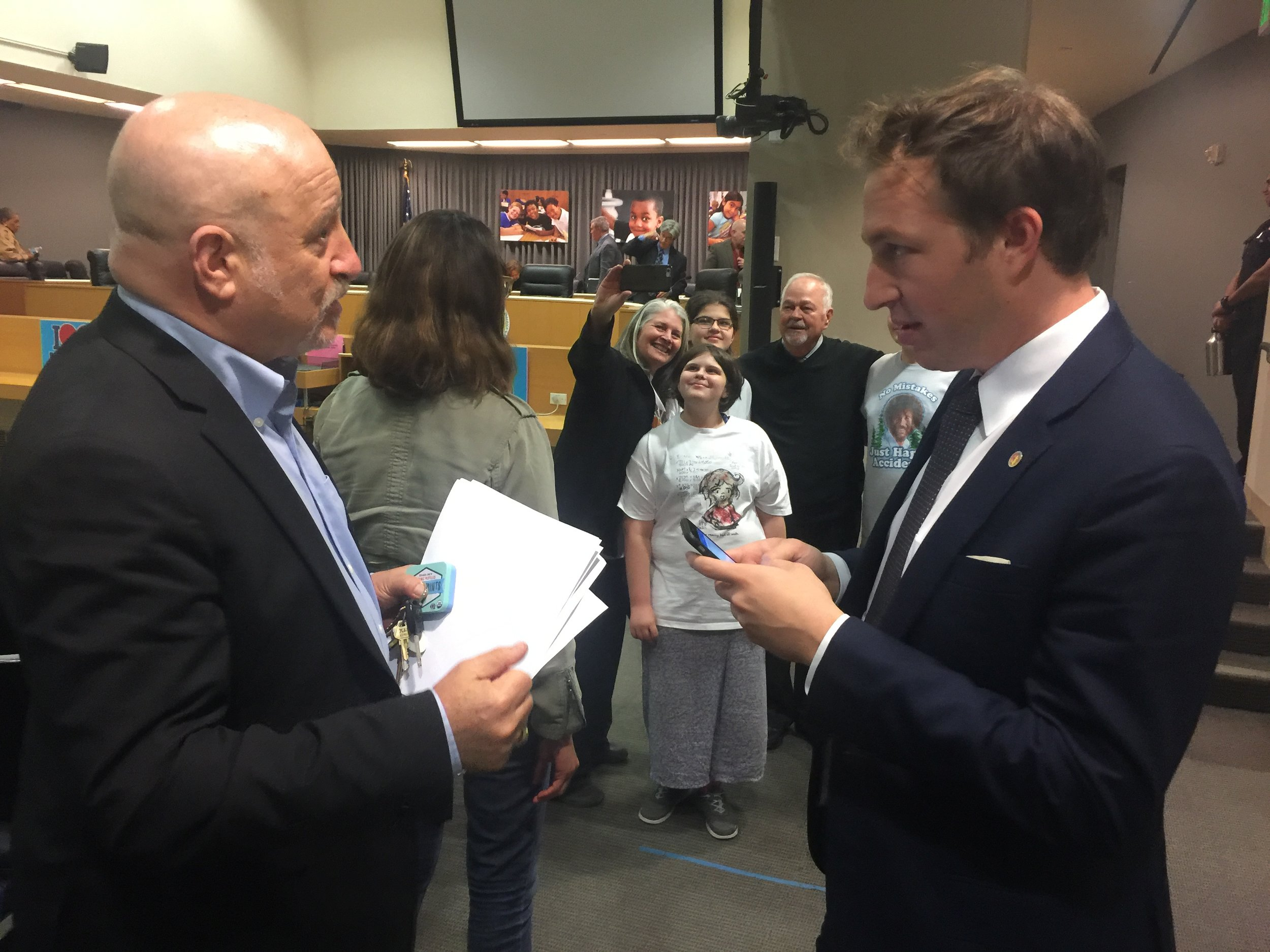 Parent Leader Michael Segel Talks to Board Vice President Nick Melvoin. Parent Harri O'Kelly and her kids chat in the background with Board Member Richard Vladovic