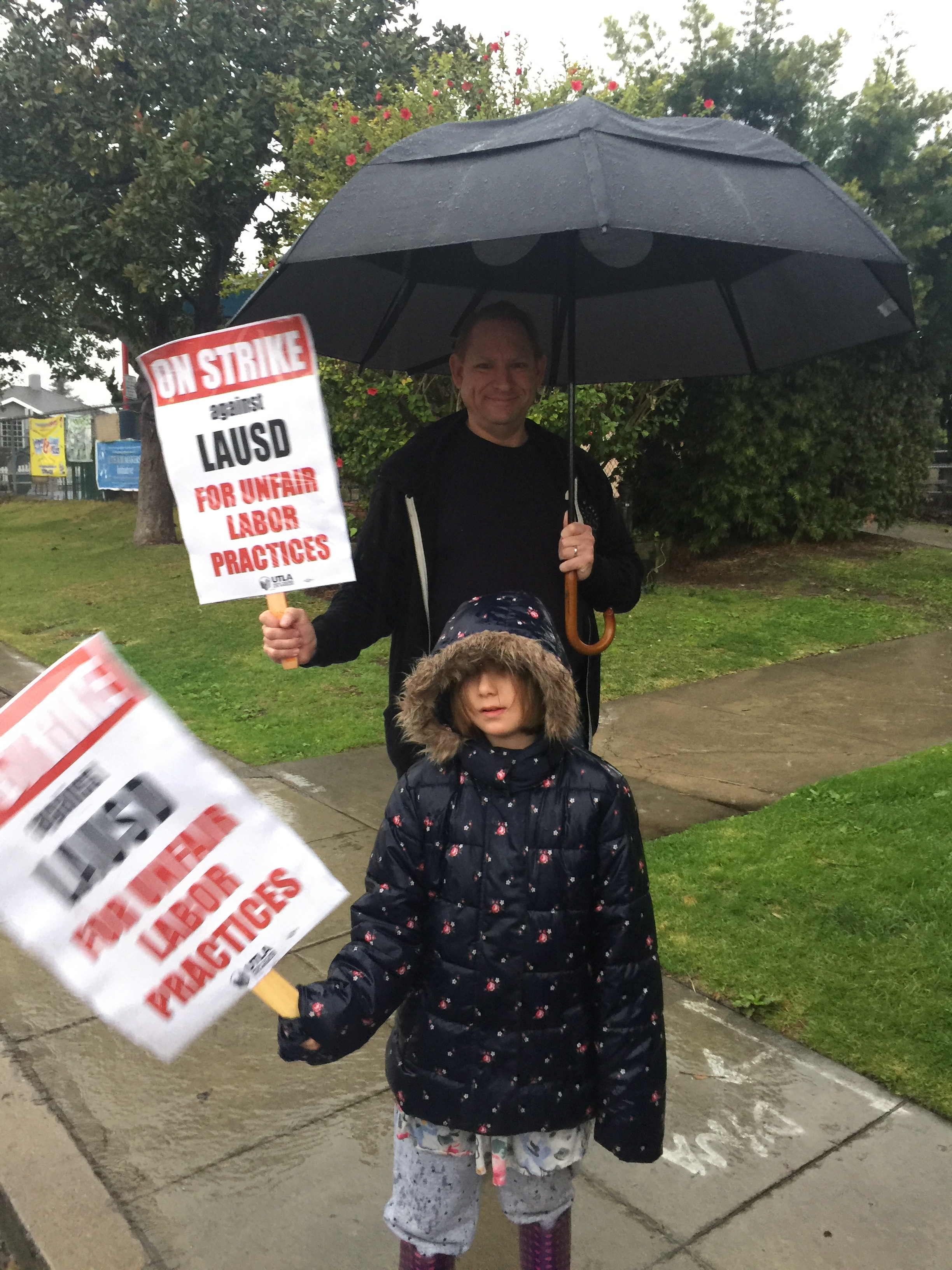 One parent and child picketed with teachers at Westport Heights elementary