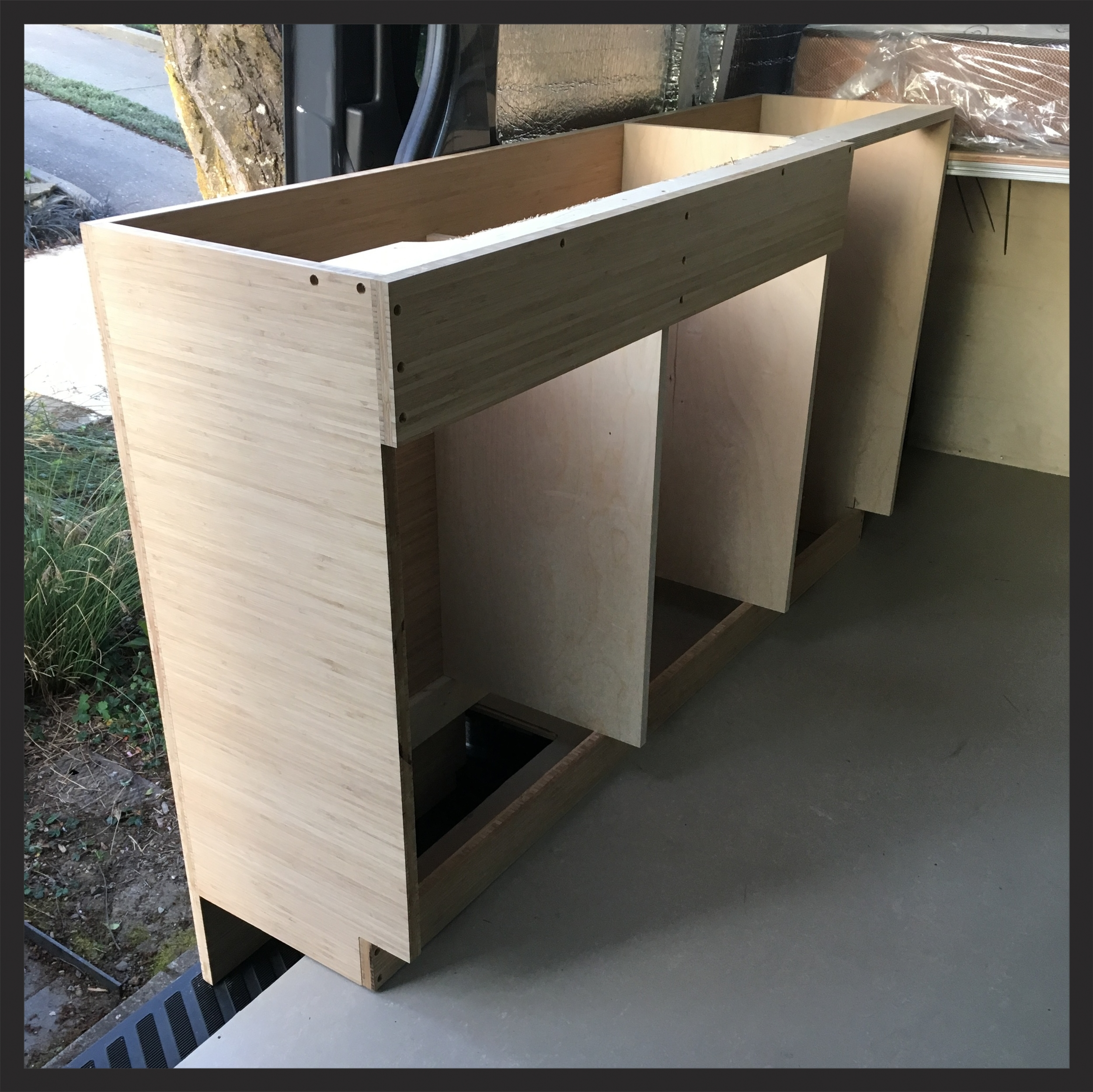 The center will have the sink above it and will have a door in front, the left and side will be drawers.