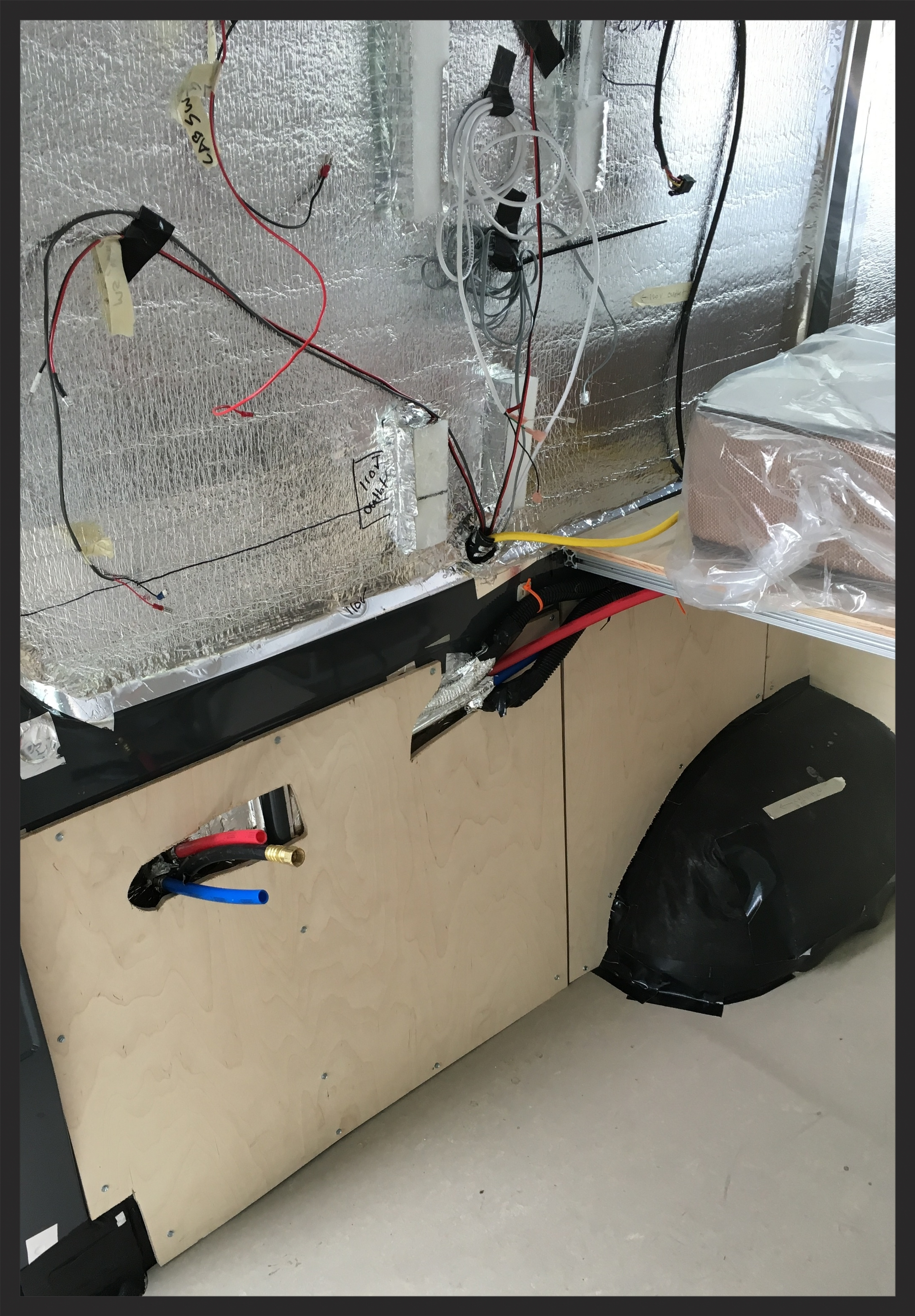 what the electrical looks like before the panel and cabinet are installed.