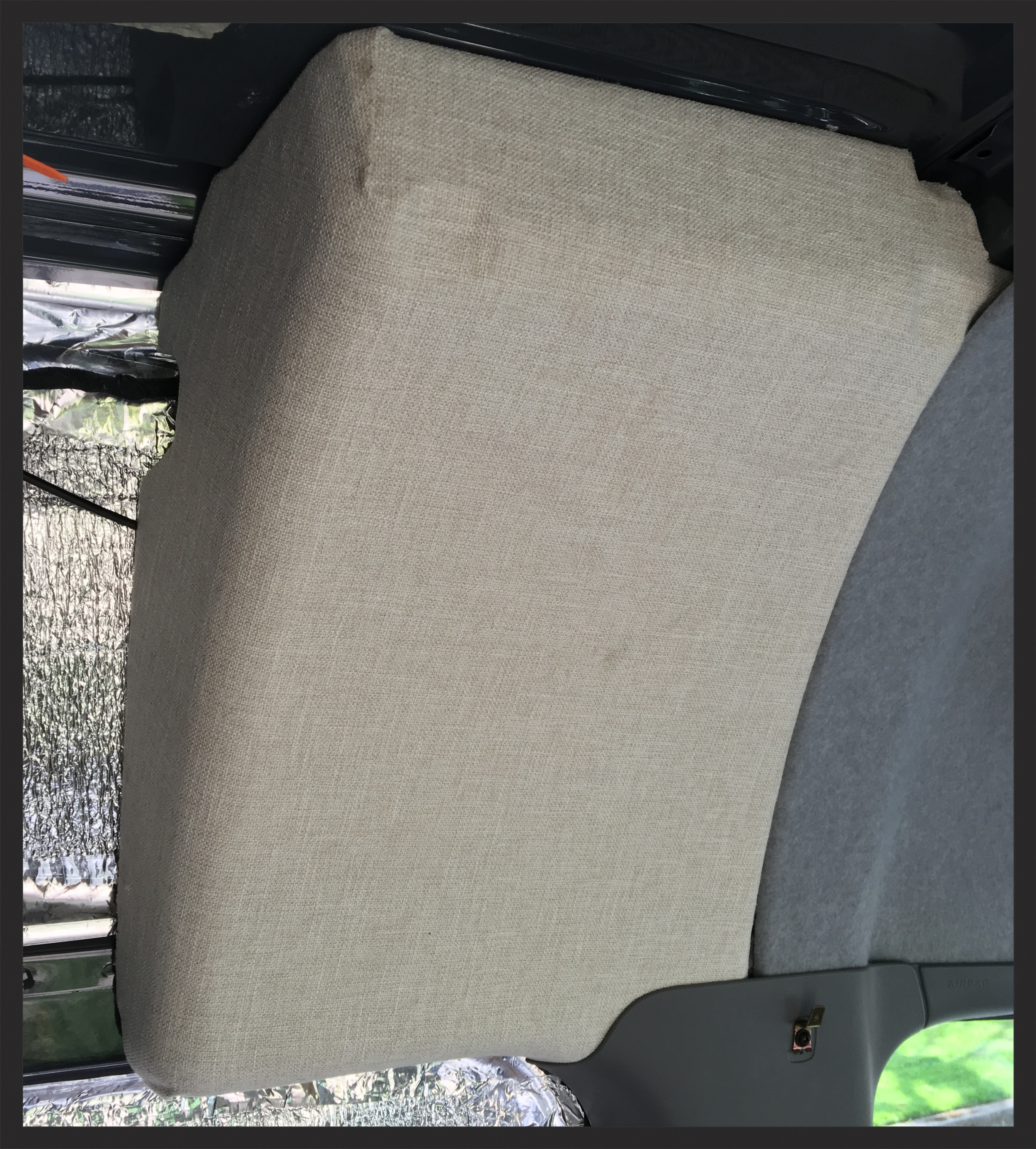 The purpose of these foam blocks is unclear--but they do cover a hole between the headliner in the cab and the cargo area, so we just covered them in cloth