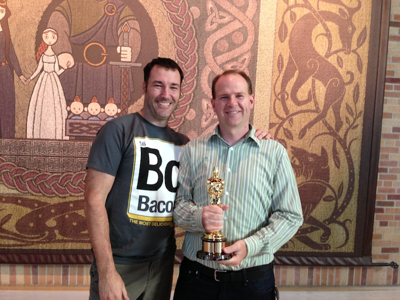 Mike Sundy holding Oscar at Pixar