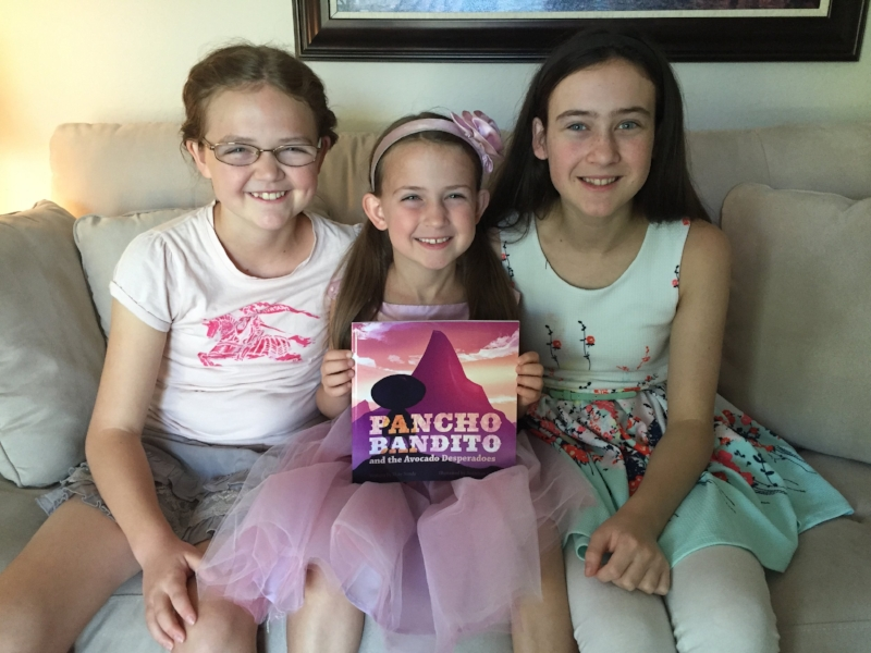 My three legbugs holding the paperback version of Pancho 2.