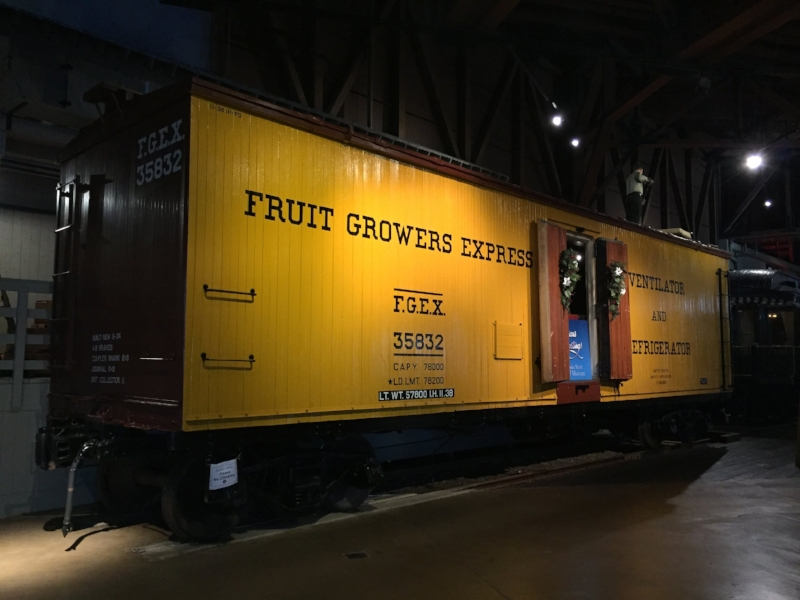 Refrigerator (reefer) car from California Train Museum.  Note how the doors swing and their color.  Bright colors like yellow or orange were used for refrigerator cars because their contents had to be tended to in the rail yard first.