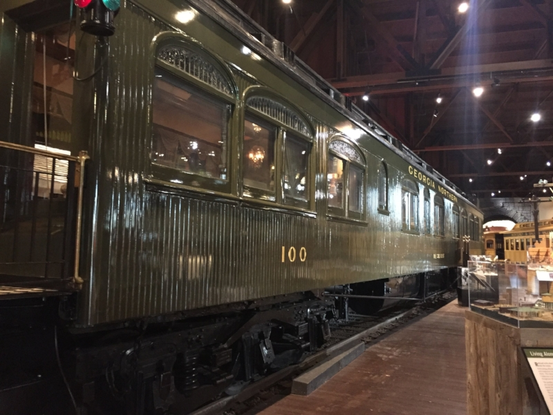 Note the arched windows and unique green color on this lovely parlor car.