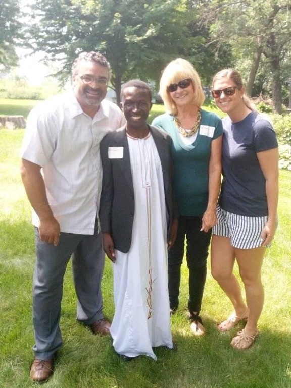 Bruhan pictured with Pastor Paul Dean of Resurrection Lutheran Church (left) and Co-Founder and Board Member of Friends of TASAAGA, Linda Kraemer (second to left).