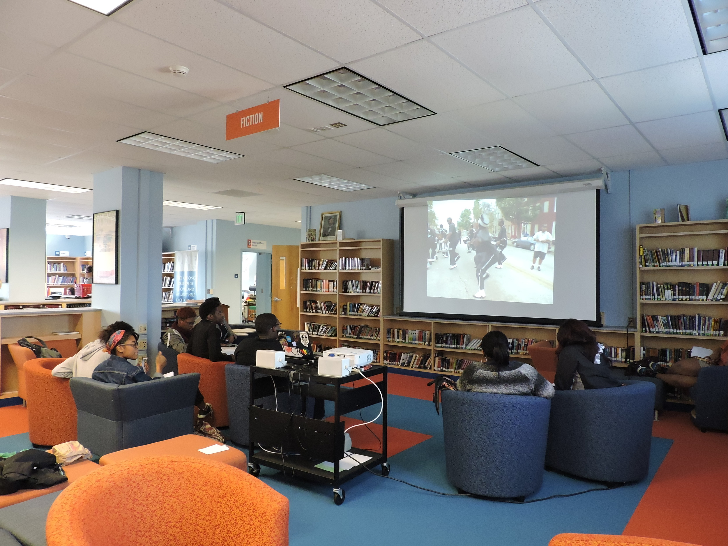"""Students watching the documentary """"Boys of Baraka"""" based on a group of students from Baltimore who studied abroad in Kenya, Africa in 2005."""