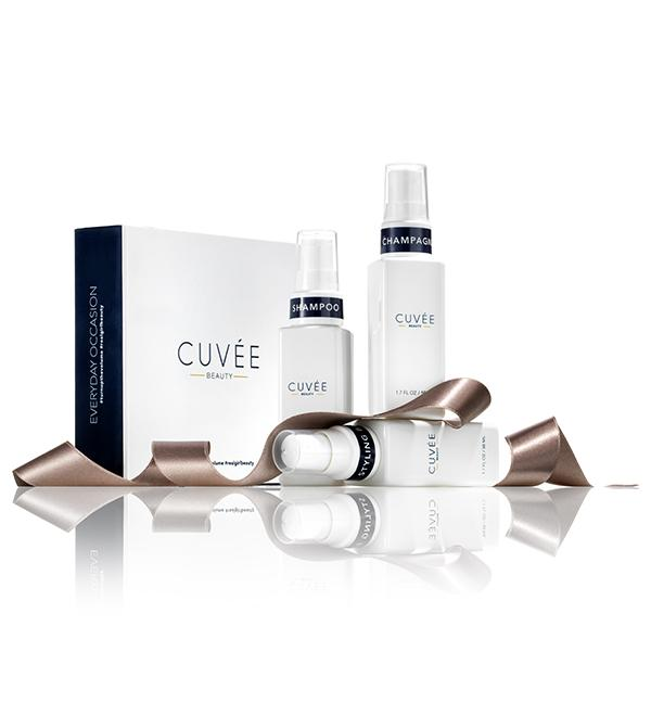 The brand's travel kit comes with shampoo, champagne spray, and styling balm.