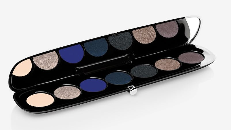 """EYE-CONIC Eyeshadow Palette in Smartorial - Sarah used the shade """"In Doubt"""" from this palette to give Gaga her graphic winged liner in this look. For ultimate impact, use a small pointed brush with water to create the pigmented look. You can also use a waterproof gel to make any shadow liner extra long lasting."""