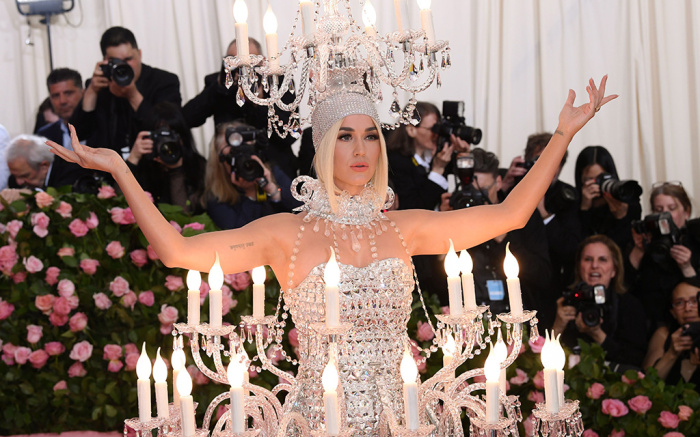 The queen of camp showed up as a chandelier and left as a  burger .