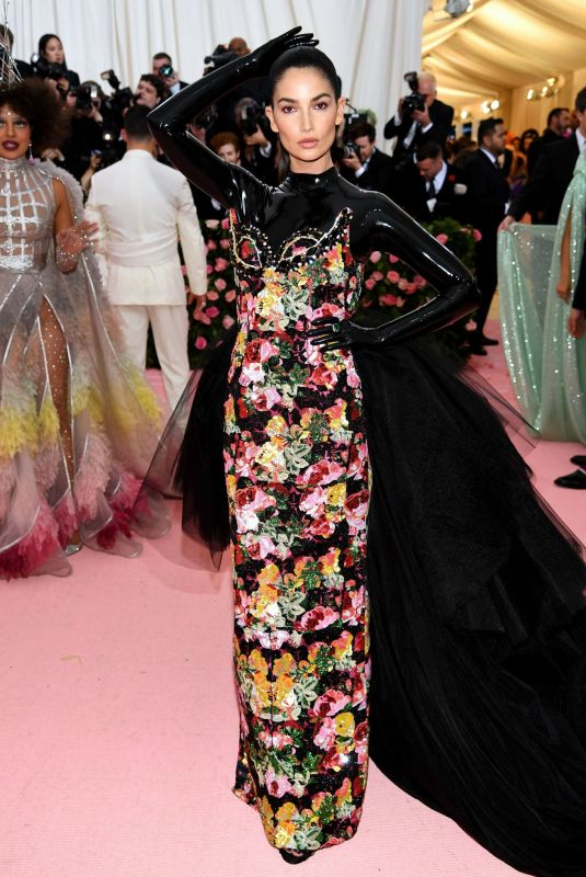 Latex  and  florals! What can't she do?