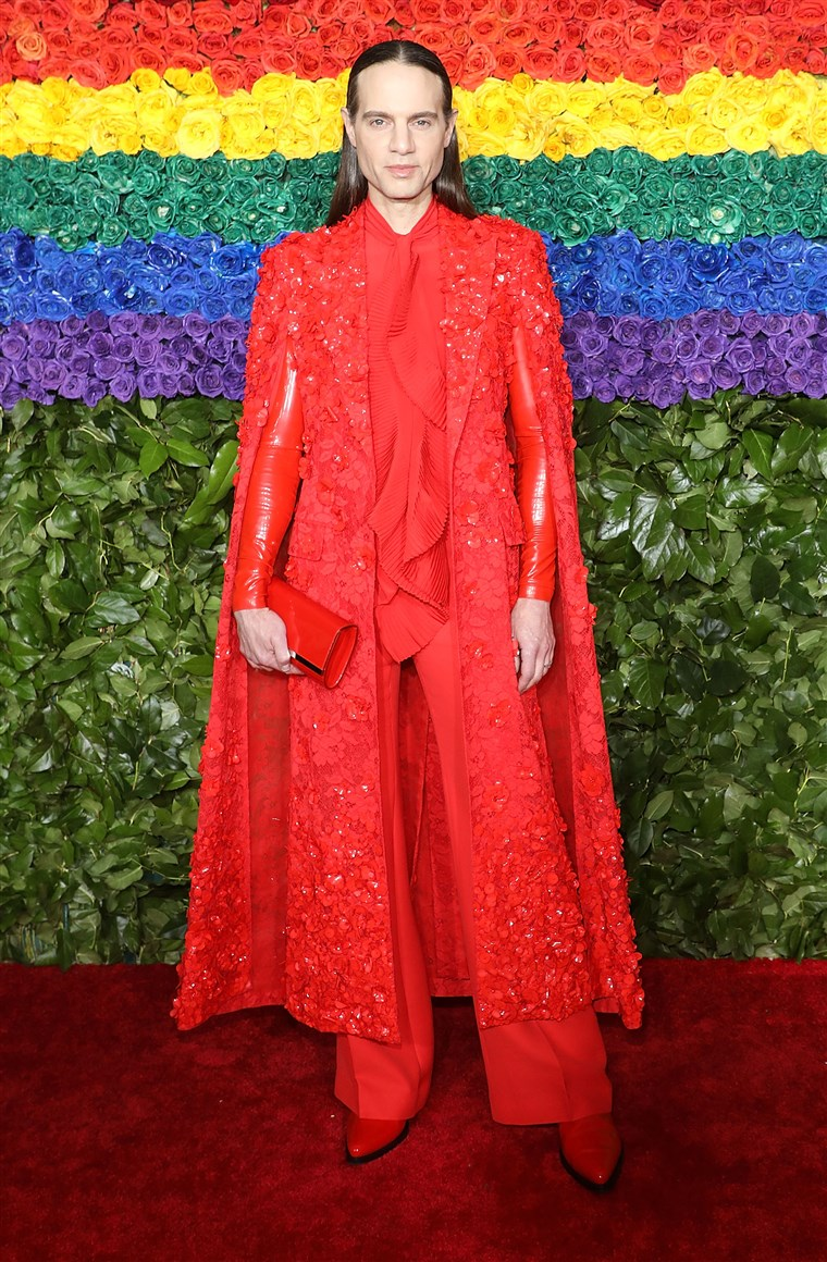 The Broadway mogul makes another statement in red with sleek hair.