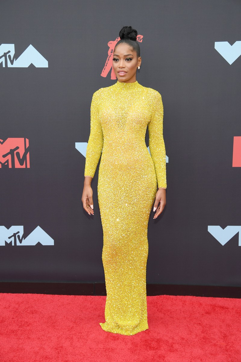 Keke stunned in this yellow couture piece and whipped out a chunky gold cell phone later on the carpet.